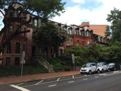Historic rowhouses, trees, bike lane, and car-sharing in Dupont Circle.