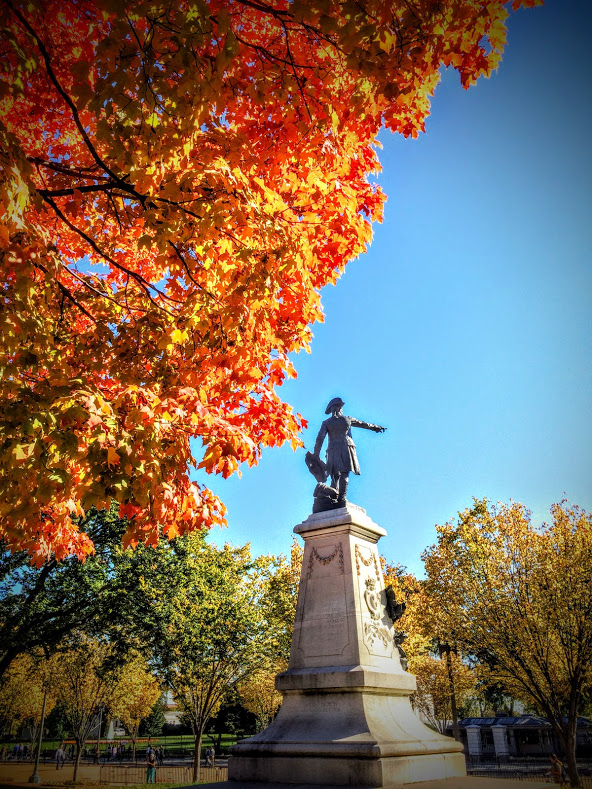 One of the park's four resplendent maple trees and Marshal Jean-Baptiste Donatien de Vimeur, comte de Rochambeau, enjoying a beautiful fall day in D.C.